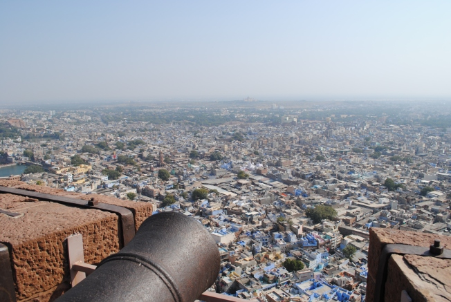 Cannon at the fort wall and the view of the blue city